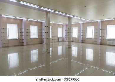 Spacious new light room space with empty glass showcases