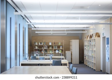 Spacious reading-room interior, rows of free tables