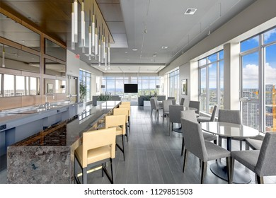 Spacious resident lounge equipped with a kitchen and wet bar in a luxury apartment building. Northwest, USA