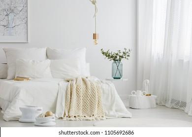 Spacious scandi bedroom interior with big window and minimalist decoration