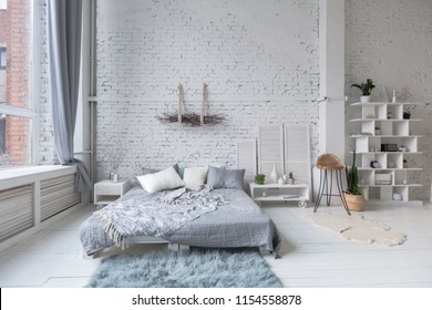spacious stylish loft apartment in white and light colors. large room with nobody full of sun light