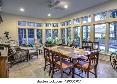 spacious sunroom with diningroom table