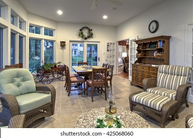 spacious sunroom with furniture and view