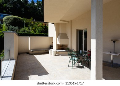 Spacious terrace of modern villa with lake view. Nobody inside