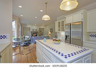 Spacious white kitchen interior with new Stainless steel appliances and tons of natural light.