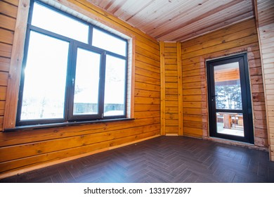 Spacious wooden room with large windows