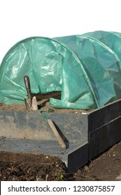 spade raised garden bed and polytunnels