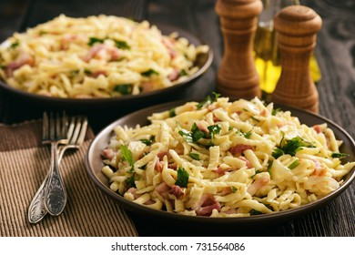 Spaetzle with bacon and onion, german style cuisine.