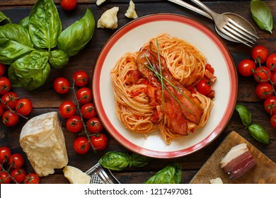 Spaghetti alla amatriciana on a wooden table top view