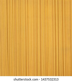 Spaghetti background - for food concepts, designs and banners - in natural, raw colors, with plenty of text / design space.