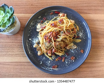 Spaghetti bacon mushroom and dried chilli with cheese