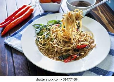 Spaghetti and basil pork with Asian food.