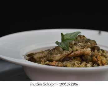 Spaghetti Black Pepper Shrimp in white plate on black background, Garlicky and buttery shrimp in a savory black pepper sauce.Delicious food  restaurant menu - Shutterstock ID 1931592206