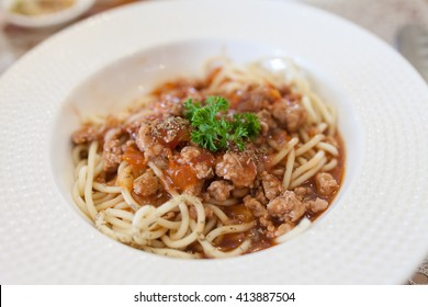 Spaghetti bolognese with cheese on a plate