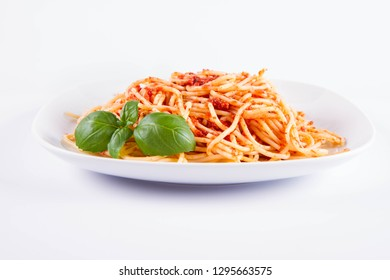 Spaghetti bolognese decorated with basil on a white background