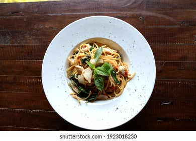 Spaghetti bolognese on a white plate on window