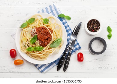 Spaghetti bolognese pasta with tomato and minced meat sauce, parmesan cheese and fresh basil. Top view