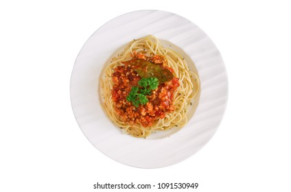 Spaghetti bolognese sauce with beef or pork,cheese,tomatoes and spices on white plate in top view flat lay, isolated background with clipping paths. Homemade delicious Italian traditional food.