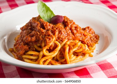 Spaghetti Bolognese sauce with olive and fresh basil in italian restaurant