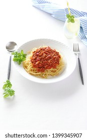 Spaghetti with bolognese sauce on white plate
