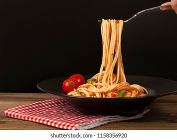 spaghetti bowl over wooden table