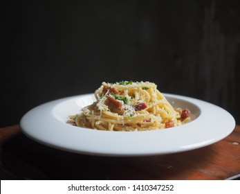 Spaghetti Carbonara dish in dark food photography style