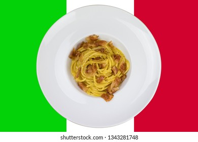 Spaghetti carbonara with egg parmesan cheese and guanciale meat. Ingredients for fresh carbonara pasta. Spaghetti carbonara. Italian recipe. Fresh food. Spaghetti carbonara on italian flag