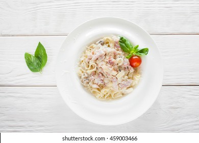Spaghetti carbonara on white wooden background, flat lay, free space. Most famous italian national meal, traditional cuisine concept