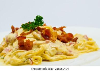 Spaghetti carbonara served with bacon