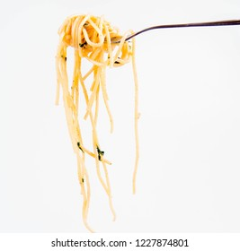 Spaghetti Carbonara with some parsley on a fork on a white background