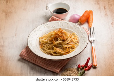 spaghetti with carrot soy sauce and sesame seed