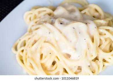 spaghetti cheese and pepper. Closeup
