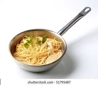 Spaghetti and cheese sauce