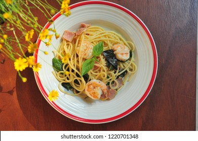 Spaghetti with chili pepper and shrimp with bacon.