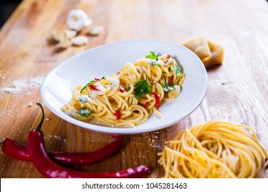 Spaghetti with chili pepper and tomato sauce. Vegetarian pasta with Parsley chilli and parmesan cheese. Fresco Pasta. Italian food. Fine dish. Horizontal frame. Macro food photography