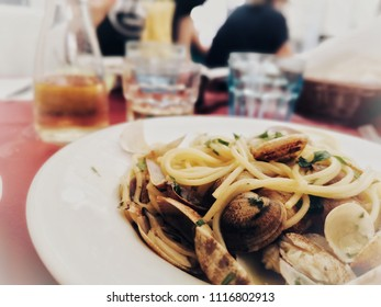 spaghetti with clams in typical Italian restaurant