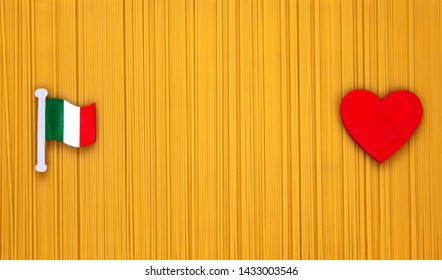 Spaghetti - food panorama background for design or original sign - homemade and traditional raw spaghetti with Italian flag and heart concept for love of cooking from Italy.