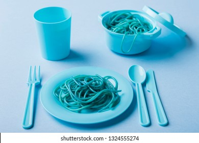 Spaghetti, fork and pot of blue color