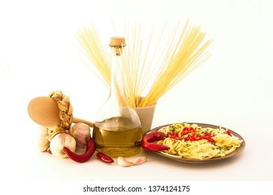 Spaghetti with garlic, oil, hot pepper on white background.Typical Italian recipe.