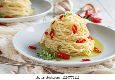 Spaghetti with garlic, olive oil and hot red  pepper close up