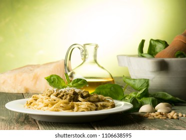spaghetti and Genoise pesto sauce with ingredients on the wooden table