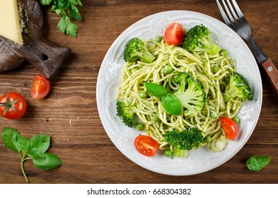 Spaghetti with green peas and basil pesto. Delicious balanced food concept