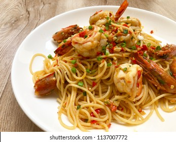 "Spaghetti Kung Pad Prik Glua or prawn stir fried with garlic, red chilli and green onion. It's is Thai fusion food that made from Thai famous menu called ""Kung Pad Prik Glua"" fried with spaghetti."