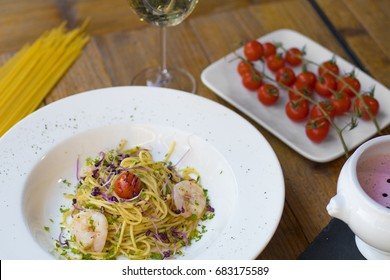 Spaghetti made with garlic and oil with shrimps and a bowl of strawbwerry soup with mascarpone