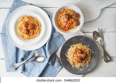 Spaghetti with meatball  on the white wooden table horizontal