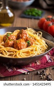 Spaghetti and meatballs, delicious italian basta mith tomato sauce in a brown plate