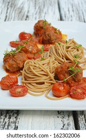 spaghetti with a meatballs, roma tomatoes and fresh thyme