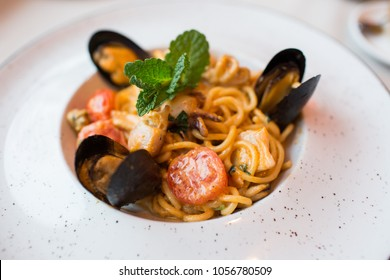 Spaghetti with mussels seafood. Soba noodles with shrimps and vegetables. Asian food. Pasta with seafood in tomato sauce. Top view.