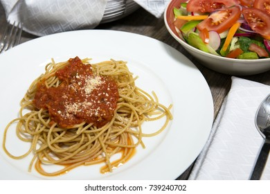 spaghetti noodles and meat sauce sprinkled with fresh grated parmesan cheese Italian style cuisine
