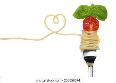 Spaghetti noodles pasta meal with heart, tomato on a fork love topic